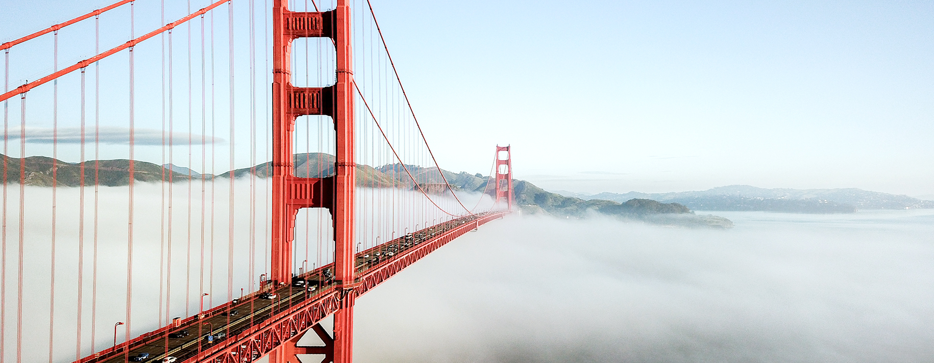 Golden gate bridge with fog underneath it in San Francisco, California.